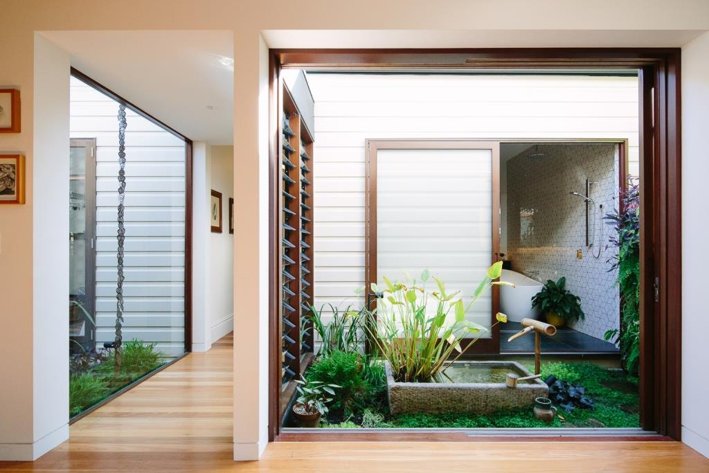 View-of-glass-link-with-Breezway-louvres-and-japanese-garden-that-joins-old-and-new-structures